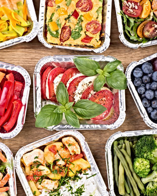 Healthy meals and salads in boxes on woo