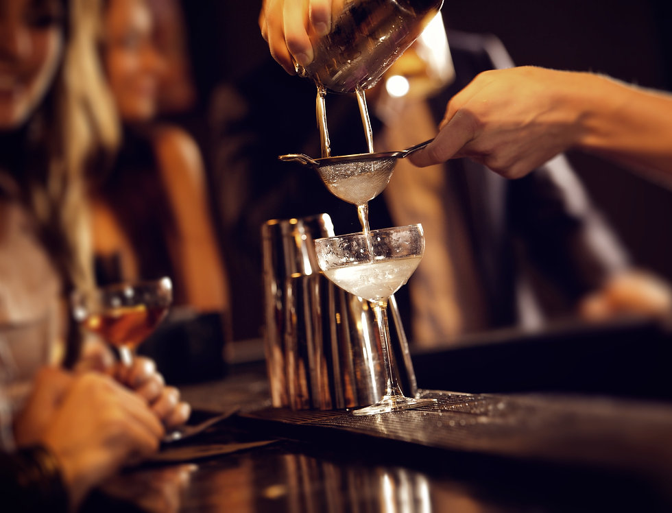 Barman pouring wine from shaker and serving it.jpg
