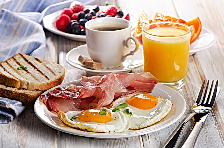 Coffee cup, Two  eggs  and bacon for hea