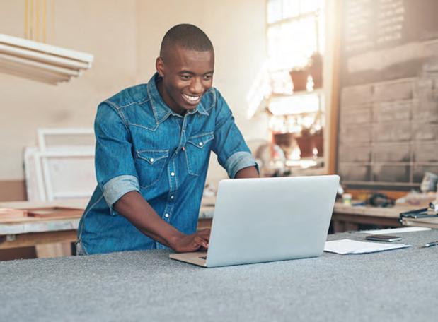 black man on laptop.png