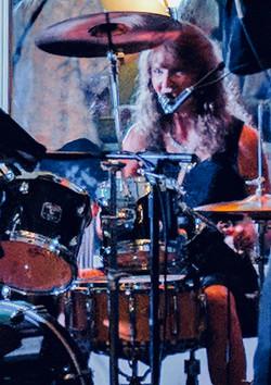 lisa behind drums