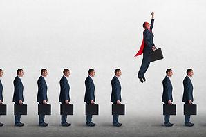 superhero businessman overcoming inertia flying away from a static queue of businessmen.jp