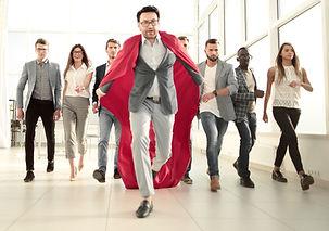 businessman in a superhero's cloak is ah