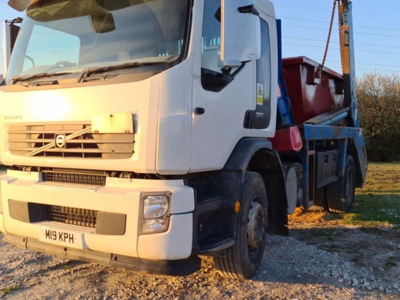 Lorry with skip on