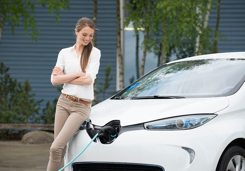 Lady charging her electric car