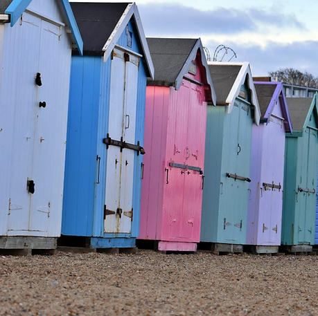 Series of colourful beach huts in the san