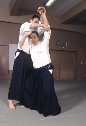 Nishio executing a dynamic hip-throw technique