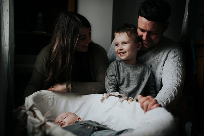 Whole family around baby