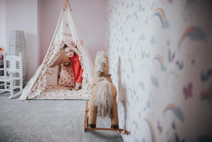 Toddler peeking through tent