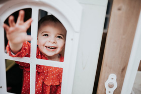 Toddler peeking through door