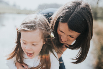 Mummy and daughter laughing