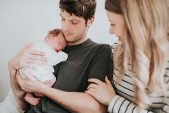 Newborn baby snuggling daddy