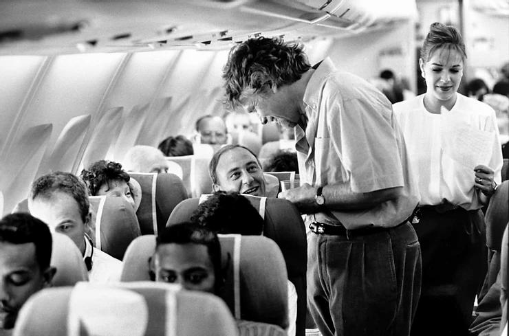 Richard Branson serving customers on Virgin Atlantic
