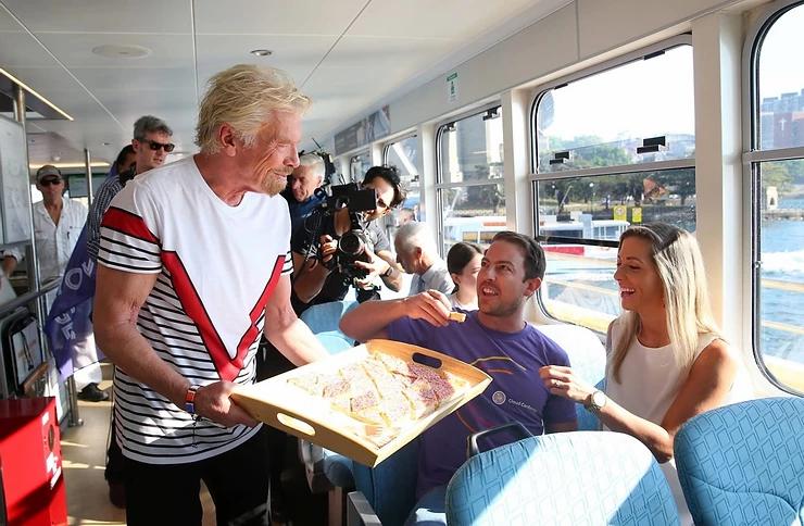 Richard Branson serving treats with Virgin Voyages
