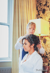 Finshing final touches on hair up