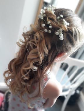 Bridesmaids hair up using gypsophilia