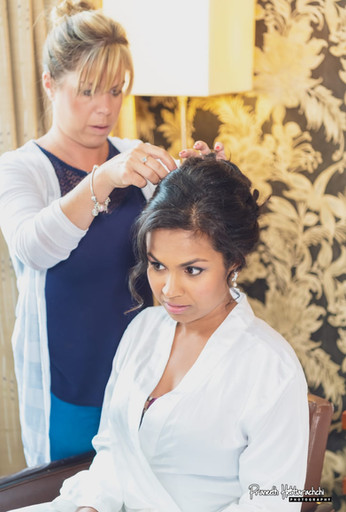 Attatching fresh flowers to bridal hair up