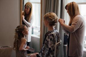 Also showing bridesmaids hair half up half down