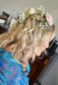 bridal hair with flowrs and plaits