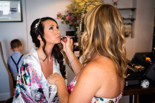 Classic bridal make-up using pinks and taupes