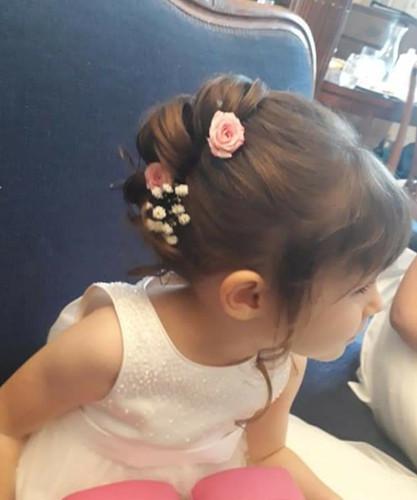 Flower girl hair up using fresh flowers