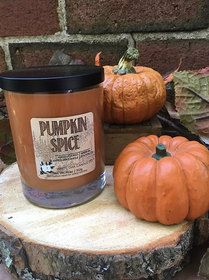 Pumpkin Spice jar candle nestled among pumpkins