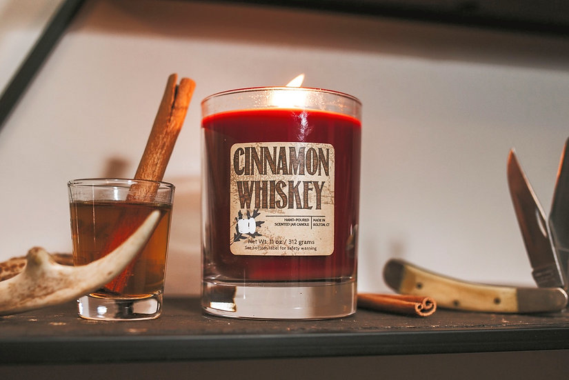 Hot cinnamon scented glass jar candle with red candle.
