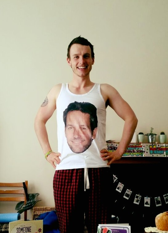 Louis, in a vest with Paul Rudds face on it.