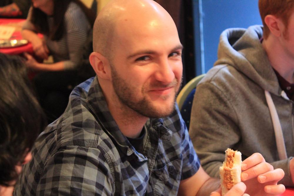 Scott, enjoying a sandwich.