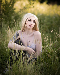 Natural Light Portraits with Sammie lounging in the long grass