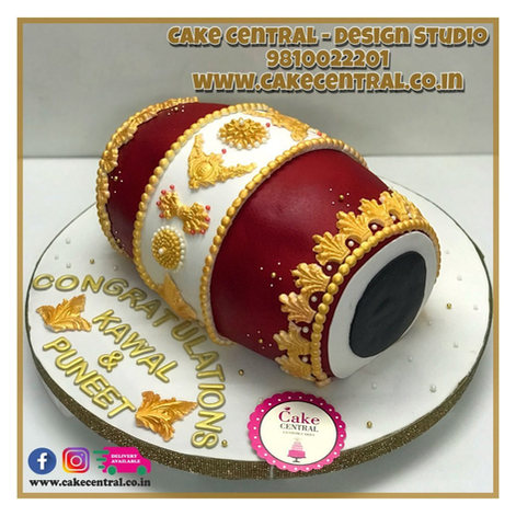 Red & Golden Dhol Shaped Cake in Delhi