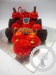 Red Racing Car / Sports Car  Themed  Birthday CupCake By Cake Central - Premier Cake Design Studio . New Delhi