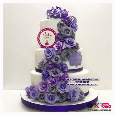 White with Blue n' Purple Roses Christian Wedding Cake Design in Delhi - Traditonal Christian  Wedding Cakes Designs Delhi Online