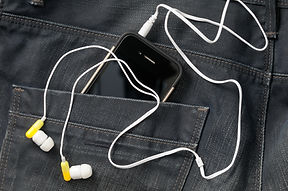 Headphones connected to phone in pocket