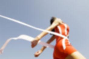 Woman Crossing Race Finish Line
