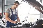 portrait-of-mechanic-at-work-in-his-gara