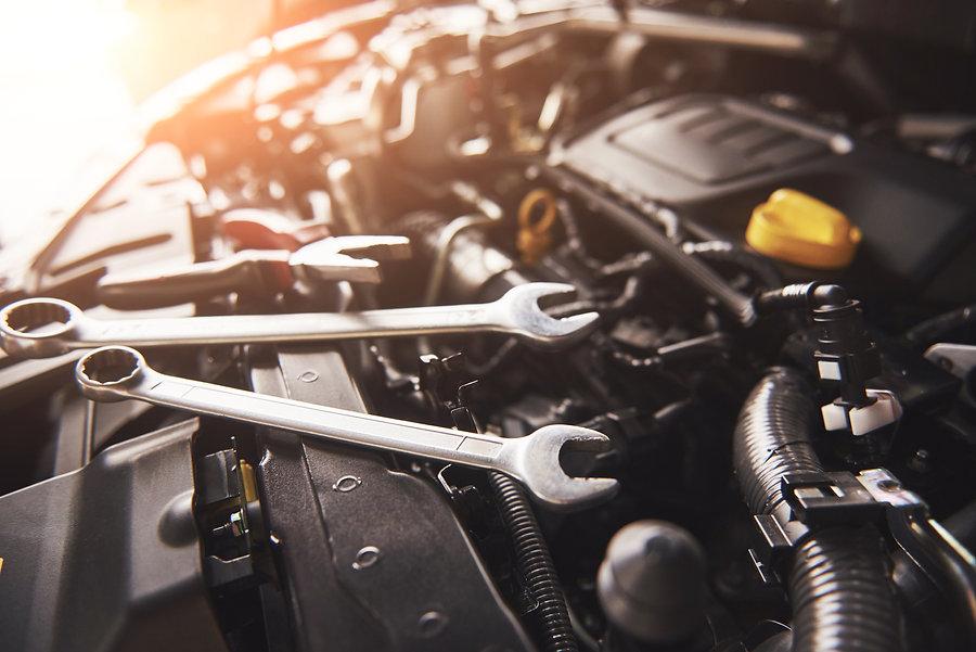 mechanic-hand-checking-and-fixing-broken