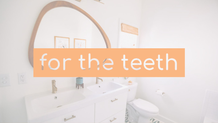 Photo of a minimalist white bathroom with a peach colored text box