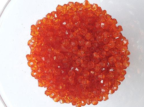 1 tube de toupies orange translucides