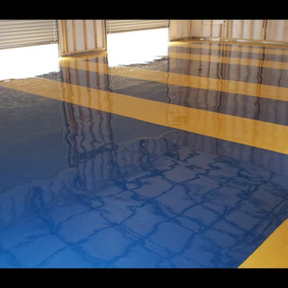 Project:  Industrial Decorative Epoxy Floor Coating System Location: Shop/Garage Pigment Colors:  Signal Yellow and Traffic Blue - Coating Colors Angier, NC May, 2020.