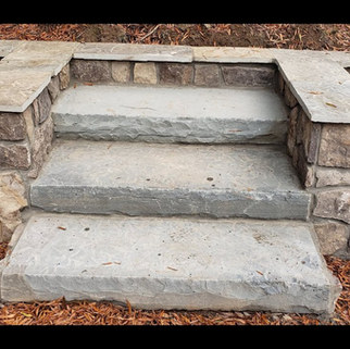 """Project:  Stone Retaining Walls, Steps, Brick Path Borders, Point up Brick Steps Stone Veneer Walls : Pennsylvania field stone Cap Stones:  Pennsylvania blue gray flag stone for cap stone  Stone Steppers: Pennsylvania blue 4"""" inch in thickness x 6 feet in width December, 2020. (Downtown) Raleigh, NC."""
