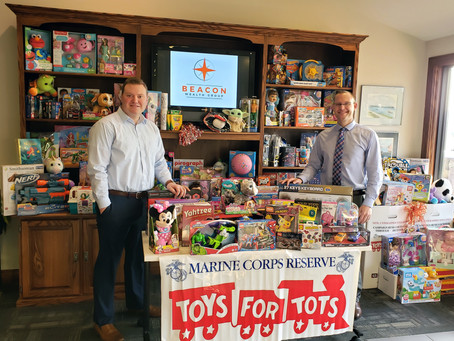 Beacon Wealth Group Collects Hundreds of Toys for Christmas Drive