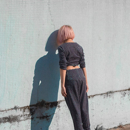 Girl Leaning on Wall