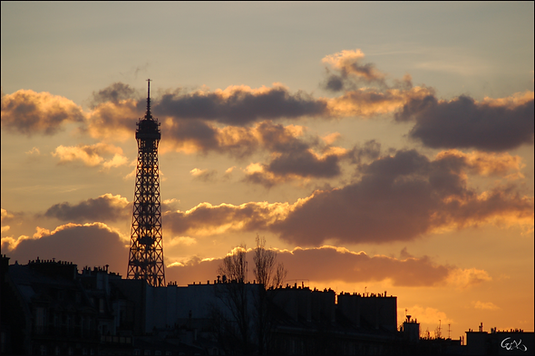 Eiffel with sunset rooftops