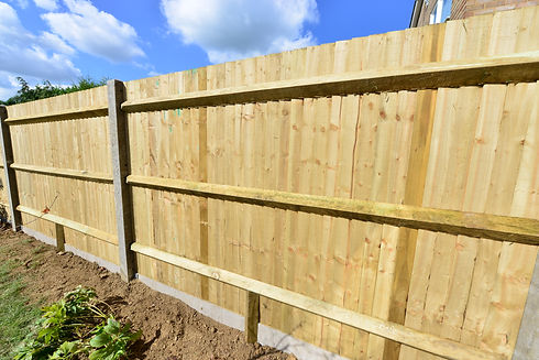 A brand new close boarded fence in the U