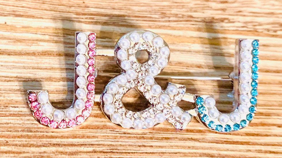 "J&J Pearl and Rhinestone pin - .75""H x 1.75""W"