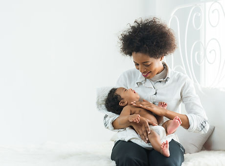 Pretty-woman-holding-a-newborn-baby-in-h