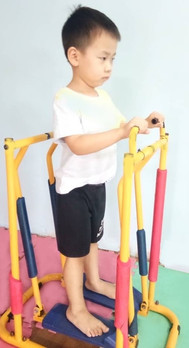 A child with autism using cross-trainer in occupational therapy session at louis centre seremban