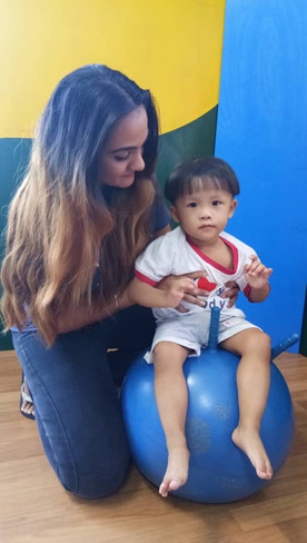 occupational therapy for autism bouncing on the gymball with occupational therapist nisha at louis autism center