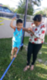 Louis Center Autism Child Occupational Therapy outdoor on  a balance rope